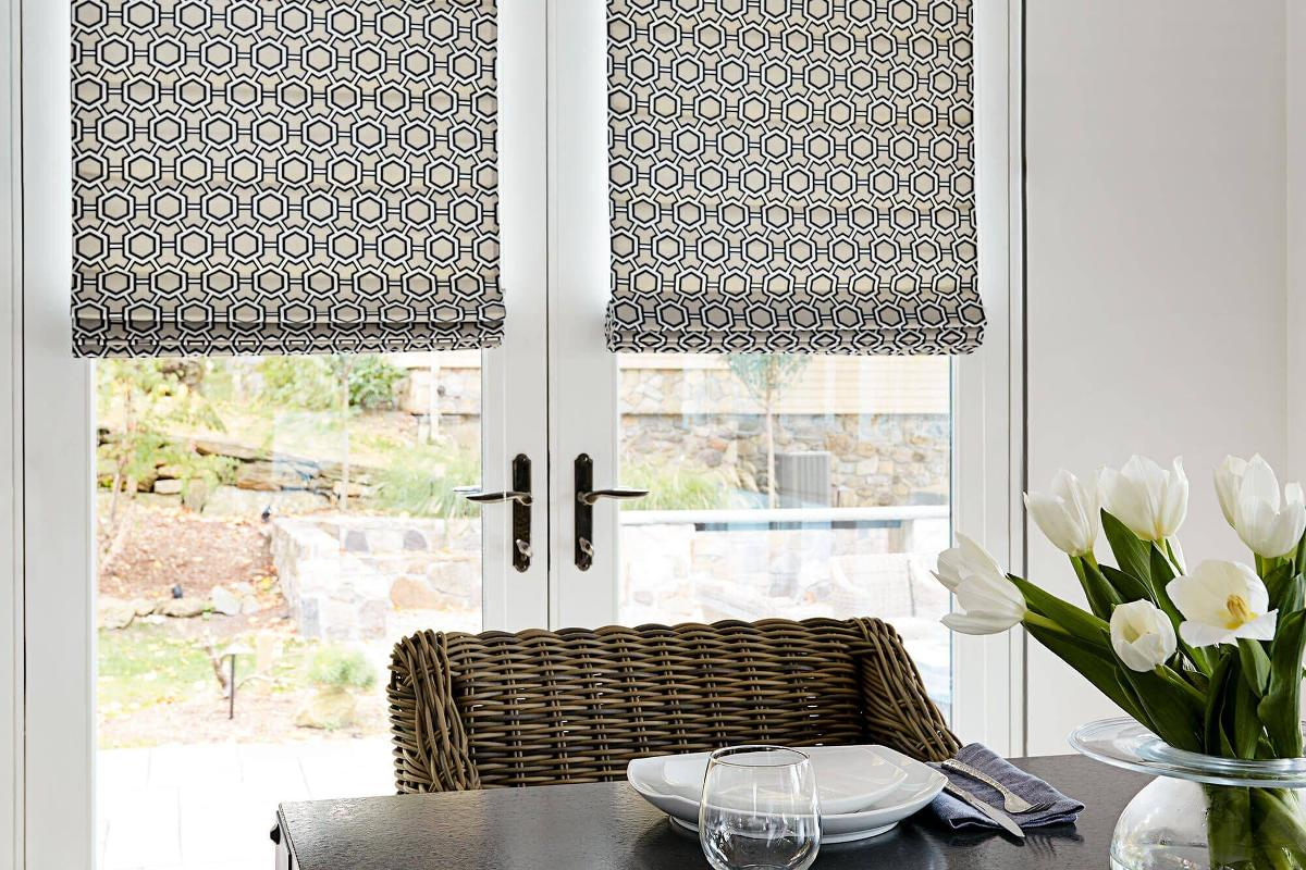 Trellis Roman Shades in a dining room setting.