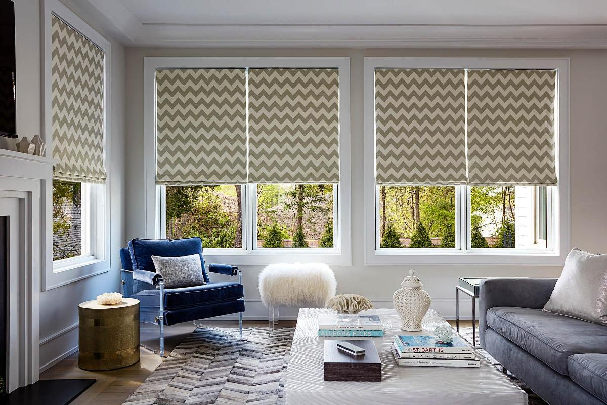 Chevron Roman Shades decorate this living room beautifully