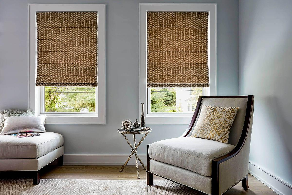 Domino Roman Shades in a bedroom setting.