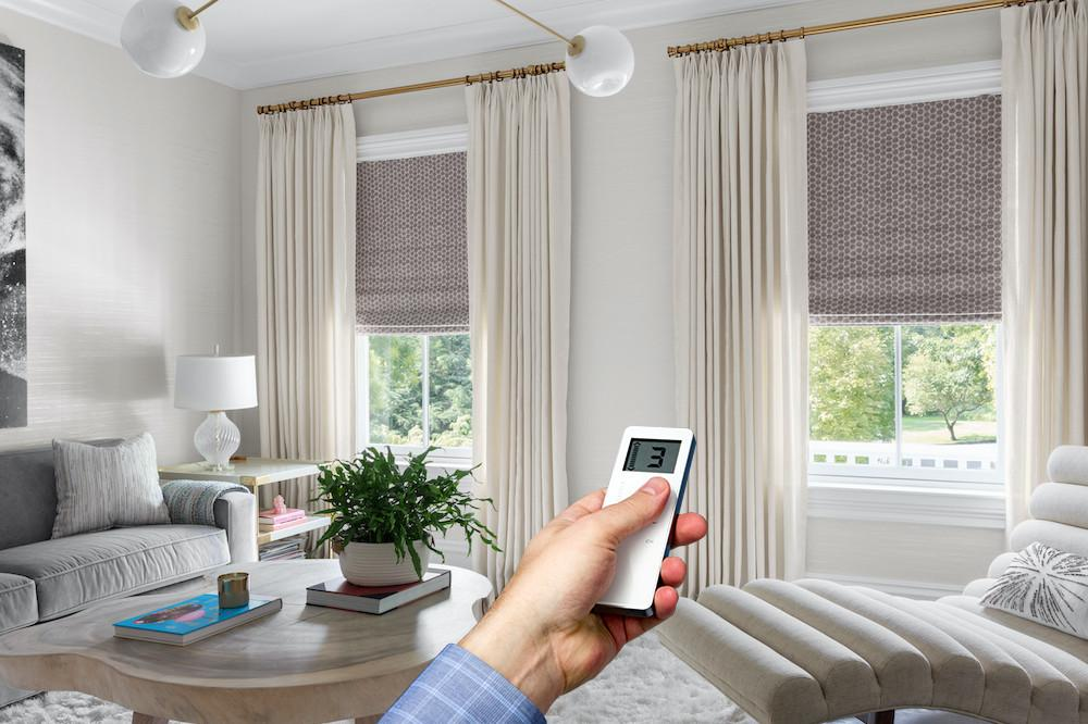 Motorized roman shades in a living room