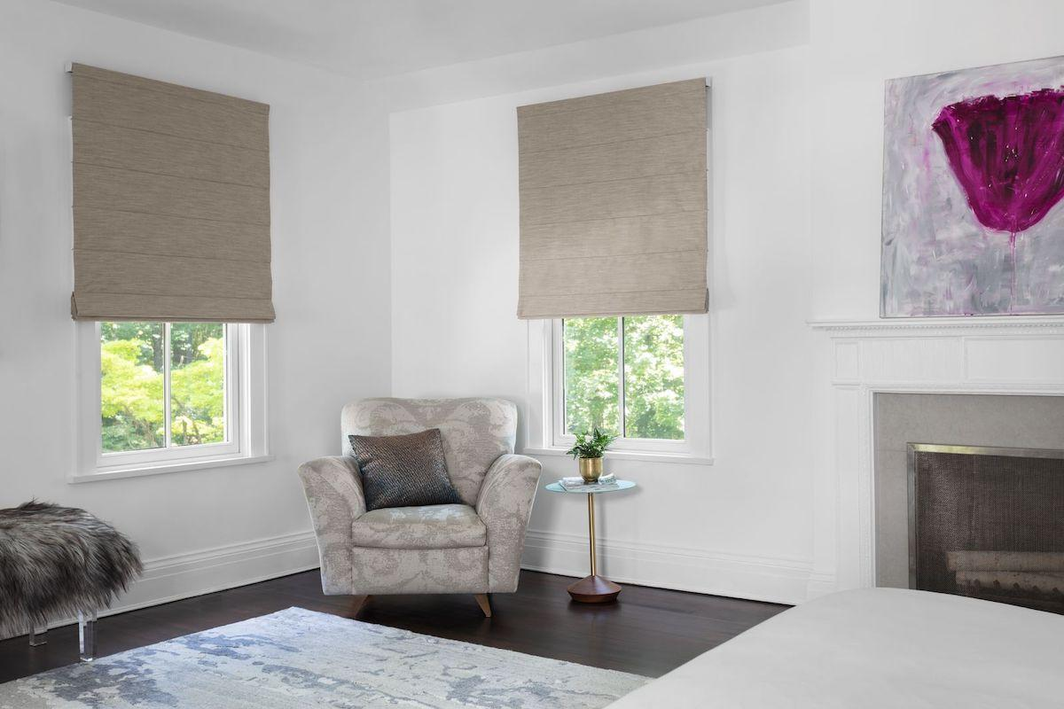 Cordless roman shades in a bedroom
