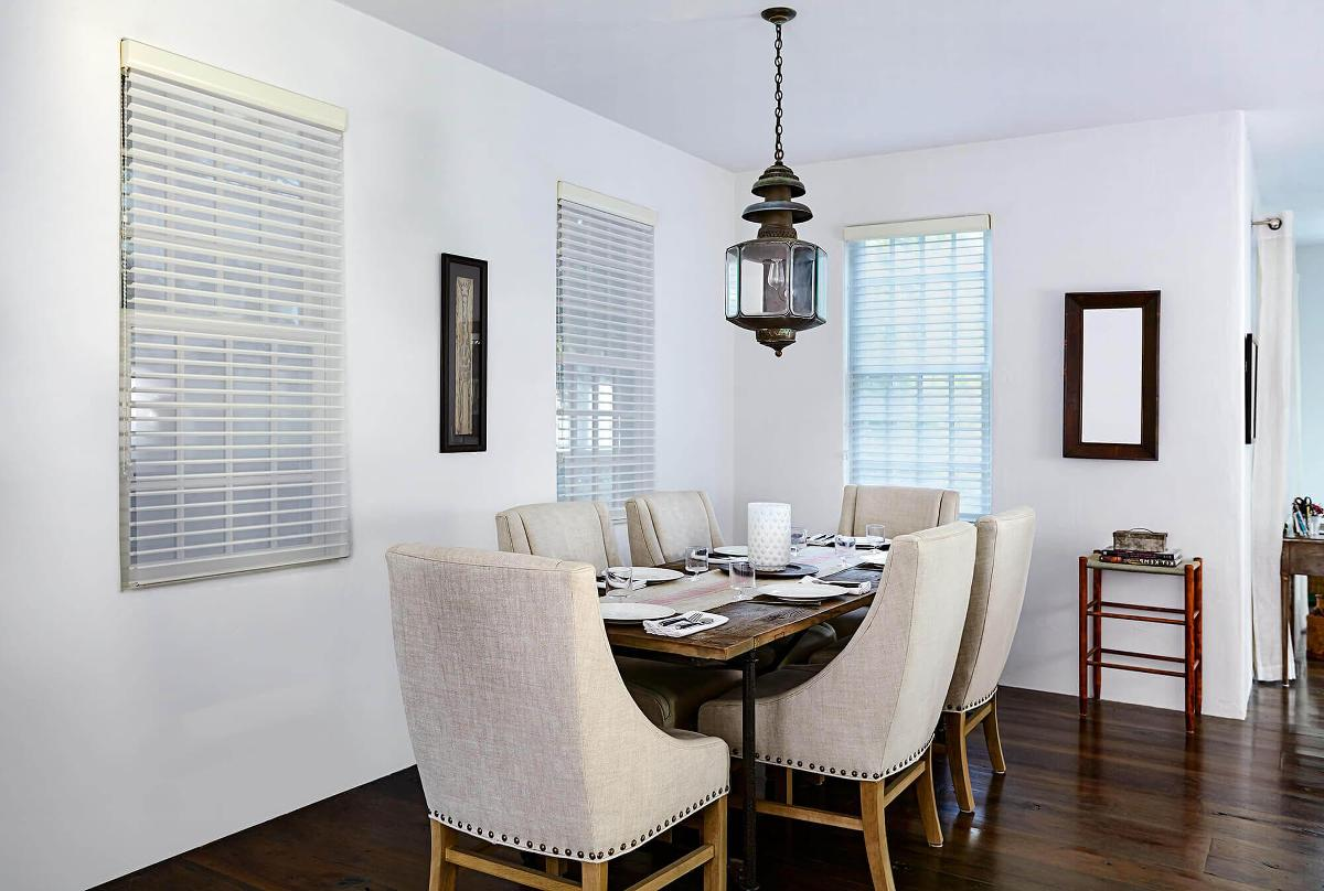 This dining room has the soft serenity shades on these long windows