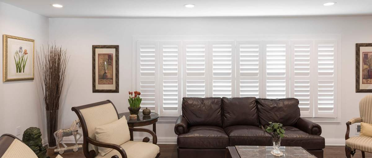 Shutters window treatment displayed in a bedroom setting.