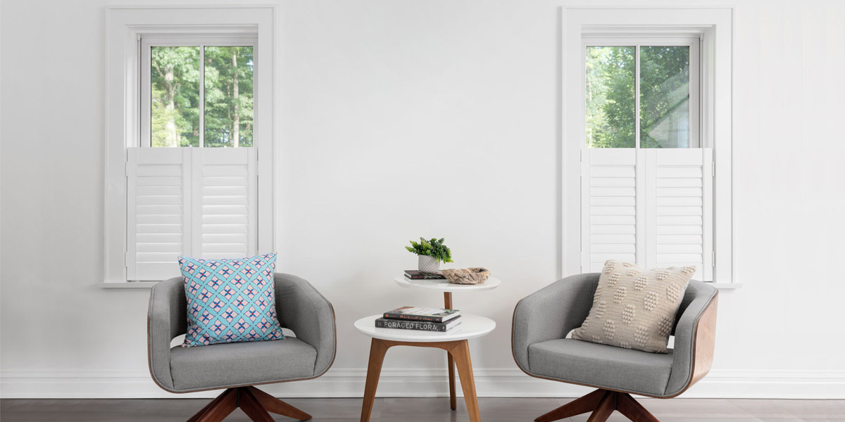 Two windows showcasing cafe style ideal shutters