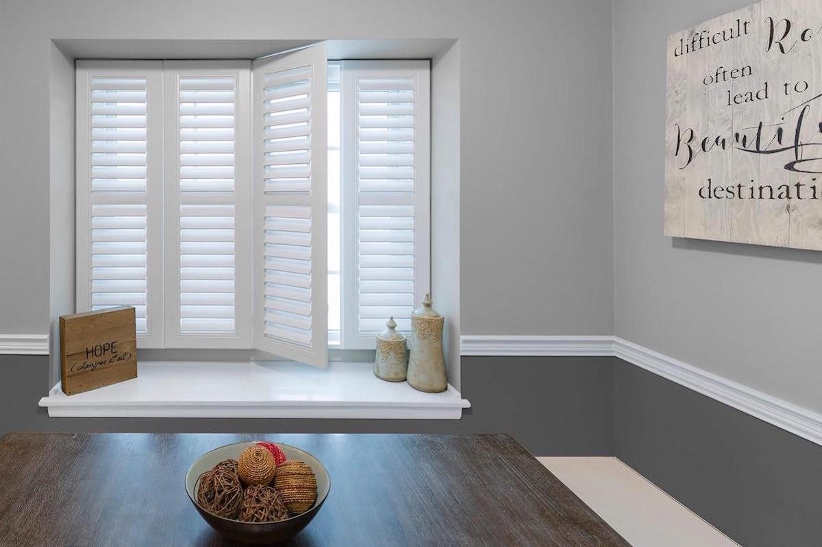White indoor shutters in a cozy dining room