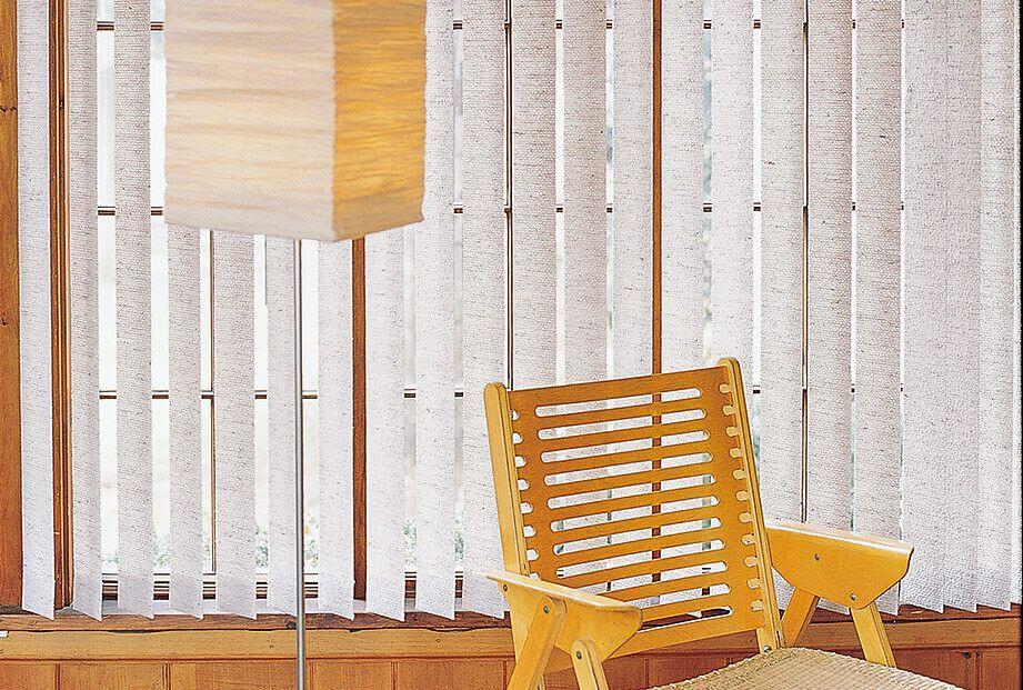 White Chagall Fabric Vertical blinds  provides a nice contrast against the wood panel.