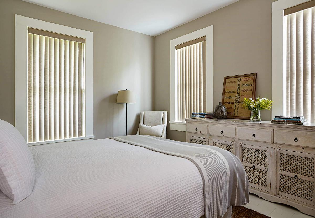 The soft style of Surah vertical vinyl blends well with the chic and neutral colors for this bedroom design