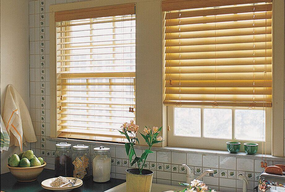 Real wood blinds in kitchen above the sink
