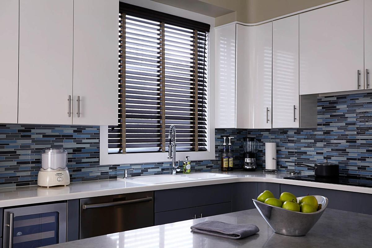 Real wood blind with fabric tape finishes the look of this contemporary kitchen