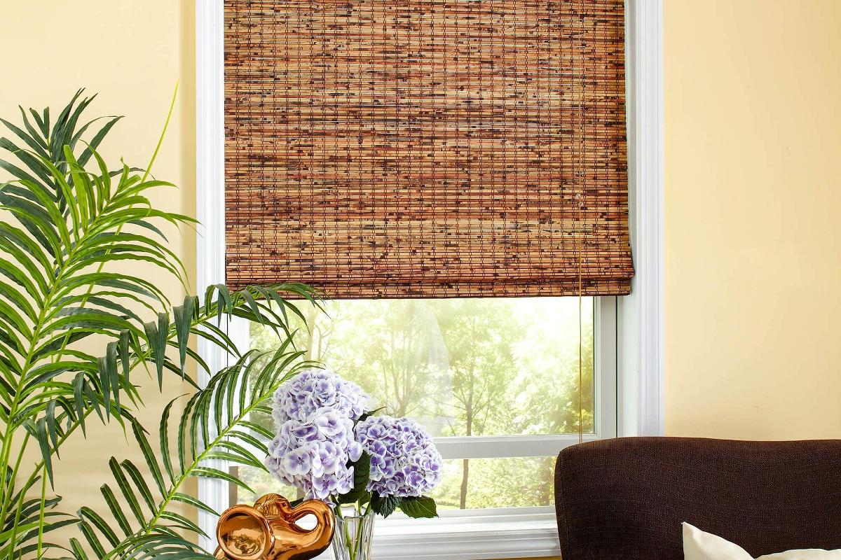 These rich mahogany woven wood shades are the perfect window treatments for any family room.