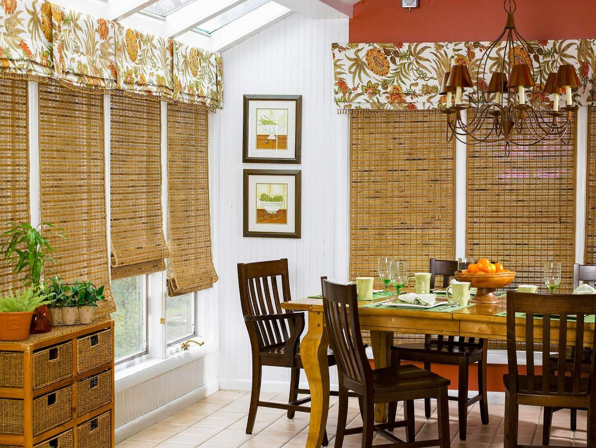 Golden brown woven wood shades help accent this dining room.