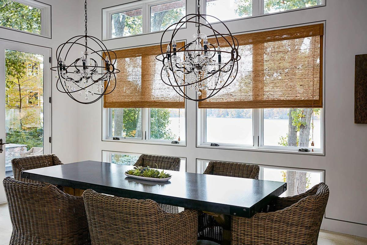These woven wood shades help dress up the dining room while still keeping the great view of the lake