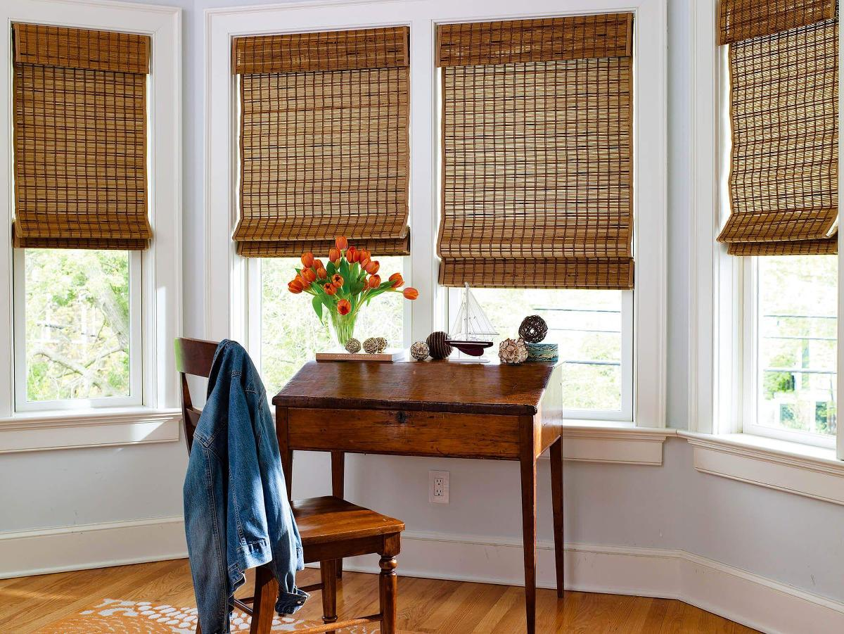 Dark brown woven wood shades sprucing up the breakfast nook. A simple yet elegant window treatment option from Blinds To Go